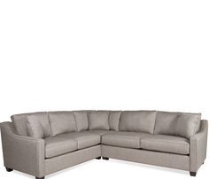With a stylish sloped arm and durable, neutral moonstone fabric with matching toss pillows, the Twilight features sinuous spring construction and high density cushions. May be special ordered in other colors and many other fabrics.