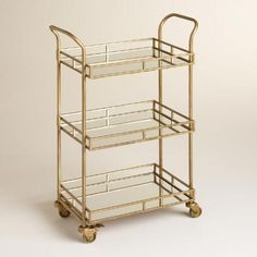 Affordable gold & mirrored bar cart for a sale price of $119, such a steal - if you sign up for the Cost Plus Explorer Rewards account you can get free shipping or 15% off taking the price down to $100! The only glamorous gold bar cart I've seen for $100! Gold Cole 3-Tier Rolling Bar Cart | World Market #GoldInvesting
