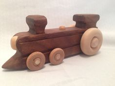 Large Wheel Wooden Train Locomotive Toy is Handcrafted from 100% Wood. (No Nails or Metal)    This simple & cute little wooden train locomotive is