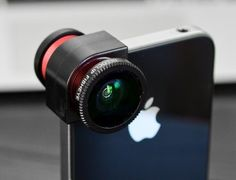 Olloclip | quick-connect lens for iPhone 5, 4 and 4S that includes fisheye, wide-angle and macro lenses. yessssssssss.   UPDATE: this thing RAWKS!! you won't believe how closeup and crisp the macro lens is. fisheye, also excellent. I would absolutely buy this again