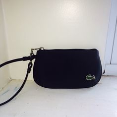 Lacoste Hand clutch Brand new! Excellent condition!! Lacoste Bags Clutches & Wristlets