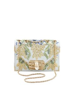 The most intricate detailing makes this bag stand out among the rest. Marchesa, 212 87 2872