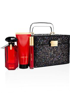 "Glitter Train Case Very Sexy  $85.00 7 1/2""L x 7""W x 5""H Fragrance type: Warm Notes: Vanilla orchid, sun-drenched clementine and midnight blackberry Case: imported polyurethane/glitter"