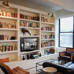 Place bookshelves on either side of the wall mounted TV