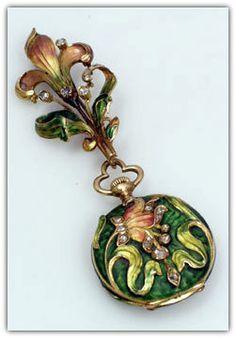 A matching Art Nouveau enamel and diamond set watch and brooch.