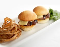 At Gordon Biersch, Try these tender Filet Mignon served on a toasted bun topped with housemade peppercorn mayo and Havarti cheese. Accompanied by baby arugula and crispy fried onions.