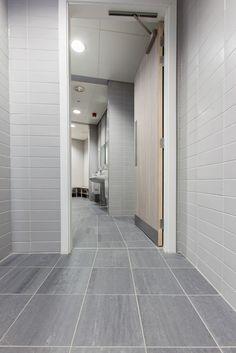 Commercial bathroom design at University. Modern grey tiles and stylish design.