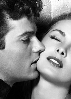 What better than real-life husband & wife?  Tony Curtis and Janet Leigh