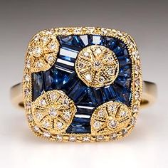 SAPPHIRE RING W/ DIAMOND ACCENTS IN 18K GOLD