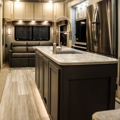 Beachfront is the color of the upper cabniets. The soft color just adds to the residential feel of our luxury fifth wheels. The island is a grey to coordinate with the custom furniture. Fifth Wheel Living, Luxury Fifth Wheel, Cabinet Island, Luxury Rv, Rv Living, Custom Furniture, Soft Colors, Kitchen, Wheels