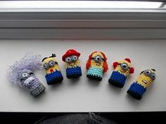 PURCHASED CROCHET pattern - finger puppets ~ Based on the much loved minion's from the films it will include instructions for making 6 different minions. Dave and Carl are pictured. Finger Crochet, Cute Crochet, Crochet For Kids, Crochet Dolls, Yarn Projects, Crochet Projects, Minion Crochet Patterns, Amigurumi Patterns, Finger Puppet Patterns