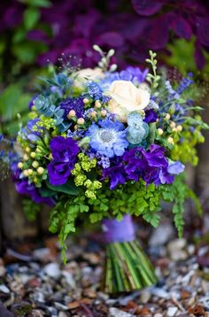 This is a lovely bouquet of pincushion, madienhair fern, viburnum berries,  roses, sweet pea, lavender, eucalyptus, viburnum and thistle.