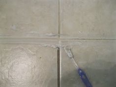home made grout cleaner.  Baking Soda and Bleach paste, used a toothbrush and a few drops of water to make it more scrubby.  The grime literally runs off.