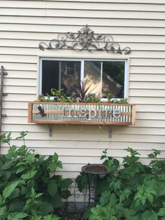 Window box made plywood, accented with mini corrugated metal, and trimmed with cedar.