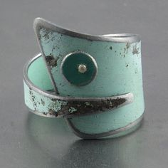 This fun and funky ring was made using metal salvaged from a silver 62 Dodge Lancer. Original car paint color. You Got Mojo Jewelry #jewelrydesign