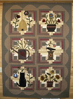 Log Cabin Garden from Buggy Barn. I could never afford the kit ($244!) but the pattern is in my price range ($13.50)