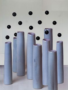 Untitled (black spheres and blue vases) by Nicole Wermers
