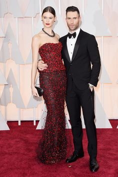 Adam Levine and Behati Prinsloo on the red carpet at the 87th Academy Awards.
