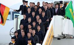 On their way: The Germany squad pose for a photo before flying to Brazil from Frankfurt ai...