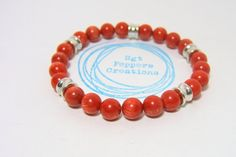 RED Bamboo Coral Bead Bracelet with Silver Metal Barrel Beads on stretch cord - 8mm beads - measures approx 7.5 inches #sgtpepperscreations #redbracelet #redcoral #bamboocoral #stretchbeadbracelet