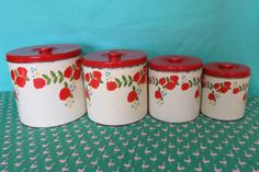 Vintage Kitsch Nesting Canisters, Set of Four 4, red and white floral canisters, retro kitchen canister set by LocaLolaRetro on Etsy https://www.etsy.com/listing/260418759/vintage-kitsch-nesting-canisters-set-of