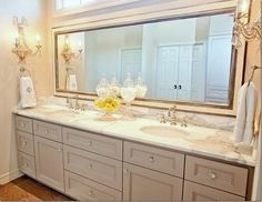 """""""Another view.  Baldwin crystal knobs.  Calacutta marble.  Custom mirror by Frametek.  Curry and Co. sconces.  Rohl faucets.  The vanity is painted BM's Ashley Gray""""  Munger Interiors"""
