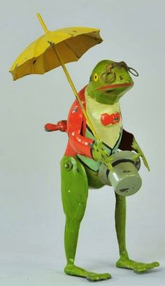 "7"" tin frog with umbrella walking toy, turnkey clockwork mechanism, restored version with repainted outer body, Germany, 1920-30, maker unknown."