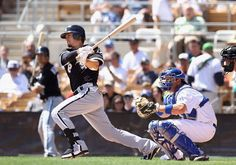 Brent Lillibridge of the Chicago White Sox hits a single against the Los Angeles Dodgers (Spring Training, 2012)