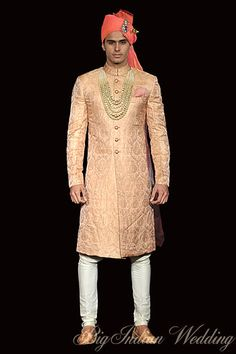 By designer Raghavendra Rathore, Jacquard peach sherwani with white churidaar. Shop for your wedding trousseau, with a personal shopper & stylist in India - Bridelan, visit our website www.bridelan.com #Bridelan #Indiangroom
