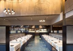 Volta restaurant in San Francisco, a brasserie designed by CCS Architecture partnered with owners Umberto Gibin and Staffan Terje. Photo: Paul Dyer. The project features Wireflow sculptural pendants, designed by Arik Levy for Vibia http://www.vibia.com/en/lamps/show/id/02994/hanging_lamps_wireflow_0299_design_by_arik_levy.html?utm_source=social&utm_medium=pinterest&utm_campaign=wiref_volta_sanfrancisco&utm_content=pint_pubutm_term=
