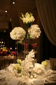 Tall glass vases... geometric... white flowers... I likey