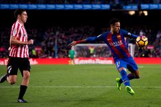 Neymar Santos Jr (R) of FC Barcelona shoots the ball next to Oscar de Marcos of Athletic Club during the La Liga match between FC Barcelona and Athletic Club at Camp Nou  stadium on February 4, 2017 in Barcelona, Catalonia.