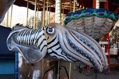 Cuttlefish Speedwell Foundation Conservation Carousel at the Smithsonian National Zoological Park is no ordinary merry-go-round. Carosel Horse, Carnival Rides, Cuttlefish, Wooden Horse, Painted Pony, Merry Go Round, Zoo Animals, Amusement Park, Fantasy