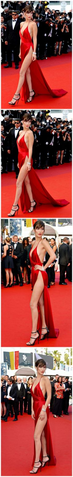 Bella Hadid in stunning red dress on red carpet.