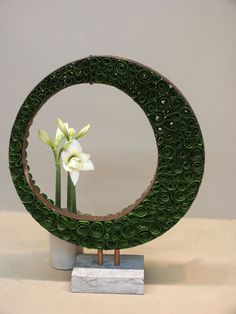 So cool with the repetitive shapes, free form and negative space...and I like the tightly rolled leaves pave