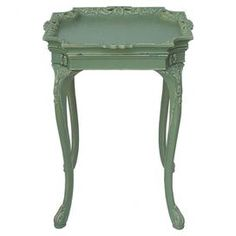Display contemporary d�cor or treasured heirlooms with this eye-catching piece, carefully hand-picked by interior designer Shane Inman.   Product: End table   Construction Material:  Wood Color:  Mint green    Features:Carved cabriole legs  Hand-carved tray lifts off to double as separate serving tray   Dimensions:  28.5 H x 20.75 W x 19 D  Note: Assembly required    Shipping: This item ships small parcelExpected