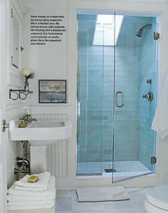Sky blue mosaic glass tiles in the shower, from The Bathroom Idea Book by Sandra Soria
