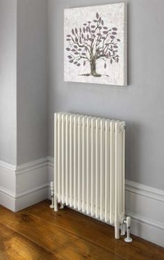 low radiator rather than high one? Ancona with slip on welded feet, 3 column, 10 sections, 750mm high, shown with Ideal TRV valves