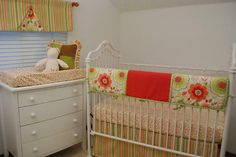 Floral and Melon Quilting Padded Crib Rail Guard with a coordinating stripe on the crib skirt and valance