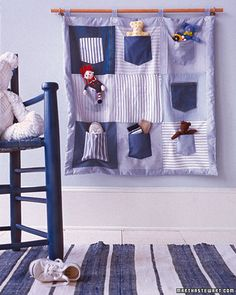 "Stuffed Animal Organizer: A shoe organizer... next to the bed? ""Each stuffed animal, with its face and arms peeking out of a pocket, will be neatly displayed and protected."""