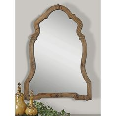 Pairing an arched silhouette with a rich walnut finish, the Augustin Wall Mirror is a distinctive addition to your decor collection. Add it to the entryway to complement a traditional ensemble or use it to round out a rustic living room look. Pair it with abstract canvas prints for a dynamic display or hang it against a bare wall to accentuate its geometric silhouette. Its wood frame matches perfectly with rustic decor and weathered accents while its understated design fits in aesthetics…