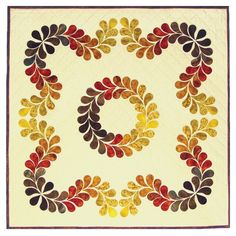 Designed by  Kay Gentry of Noble Needle Quilting & Sewing Feathers have long been a favorite motif for quilters. Feather Quilt is the first of my quilts using the feather as a design element. Colorful feathers flow from gold to dark brown on a gracefully curving border around a traditional feathered circle. The feathers can be die cut using the AccuQuilt Studio or GO! Fabric Cutters and a die shape I designed for use by quilters and crafters. The pre-cut feather shapes are fused to the…
