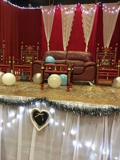 Amana&arslan our engagement stage. Diy, red velvet, white organza, red sofa with Pakistani hand made chairs, fairy lights. My night made special