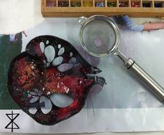 Enamelling the inside of a giant pomegranate - a large, deliciously colourful neckpiece in progress. #StudioNoraKovats © Nora Kovats