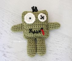 Zombies are all the rage right now, popping up in TV, movies, and even advertising campaigns. Hop on the trend with this adorable Friendly Crochet Zombie Doll! You child will love a new little amigurumi zombie friend. Crochet Baby Toys, Cute Crochet, Crochet For Kids, Crochet Animals, Crochet Crafts, Crochet Dolls, Yarn Crafts, Crochet Projects, Easy Crochet