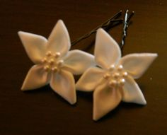 Adorable Satin Flowers attached to bobby pins, with pearl centers for a little shimmer