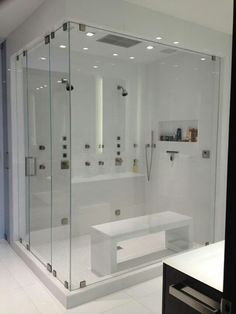 Custom master shower with glass bench.