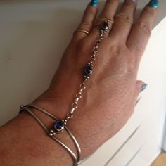"""Sterling Silver Slave Bracelet Vintage Sterling Silver slave bracelet. Stamped Sterling in multiple places. Set with gorgeous blue stones. Size: ring tight 6, cuff bracelet 7-has adjustability. Distance from bracelet to ring: 4 1/2"""". 🚫No trades🚫 Vintage Jewelry"""