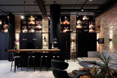 Exposed brick walls coupled with dark metallic decor creates the perfect industrial home