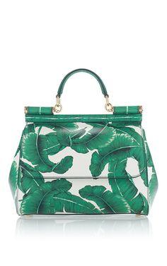 A sophisticated accessory that evokes  la dolce vita  via palm-printed  leather f35d1bb9217cf